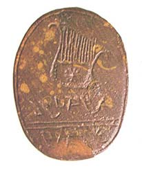 A delicate lyre decorates a brown jasper seal from Jerusalem