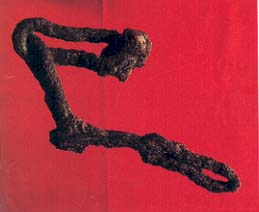 Four links of iron chain, each 10 cm long, lay in debris from the eighth century B.C. battle at Lachish.